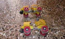 Pair Of Red And Yellow Roller Skates