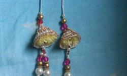 Pair Of Silver, Pearl And Gold Dangling rakhi