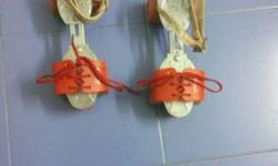 Pair Of White And Red Roller Skates