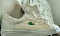 Pair Of White Lacoste Sneakers