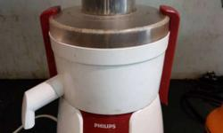 White And Red Philips Juice Extractor