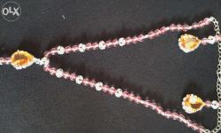 It is made of pink Pearl and saffron Big Stones. You