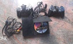 PlayStation 2 with 2 joystick. More details