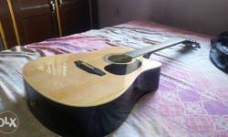 Pluto acoustic guitar with cover nd belt One year old ,