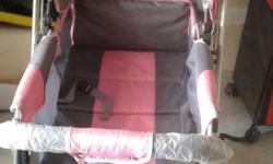baby pram new condition with break pink in colour with