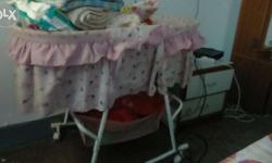 Pink colour Pram for baby girls 10 months old Has place