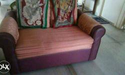 Purple And Red Loveseat