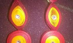 Quilled earring in red with yellow colour.its unused.