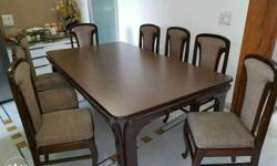 Rectangular Brown Wooden 9-piece Dining Set