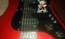 Red And Black Stratocaster Guitar