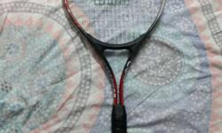 Brand new Red And Black Tennis Racket. Only played with