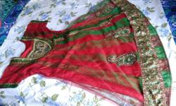 red and green net churidar along with net dupatta and