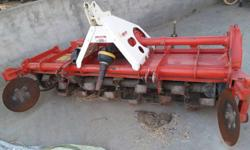 Red And White Steel Tiller