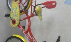 Red And Yellow Commuter Bike With Traning Wheels
