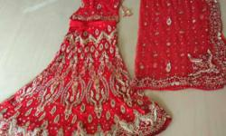Red bridal lehnga with zari work.