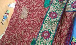 Red, Green, And Purple Floral Textile
