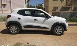 Renault Kwid white colour Rxt optional top end for