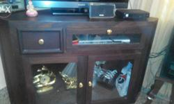 Two year old rose wood, corner TV stand, with