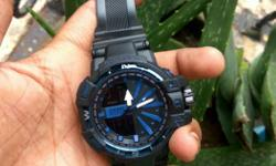 Round Black And Blue Analog Watch With Rubber Strap