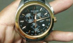 Round Gold TIssot Chronograp Watch With Black Strap in