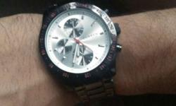 Round Silver Face Chronograph Watch With Stainless