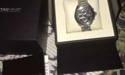 Round Silver Tag Heuer Chronograph Watch With Silver