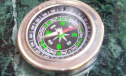 Round White And Gold Compass