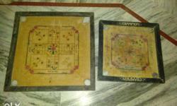 set of two carrom board. one is of small size and other