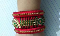 silk theard red colour bangles.with golden work