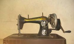 SINGER Sewing machine(Running condition). Priced at