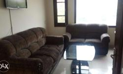 A sofa-set with center table is available for sale.