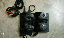 Sony playstation 2 (slim) with 2 remote and 4 games