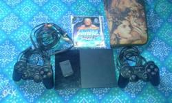 Black Sony PS2 Console With Controllers And Smack Down