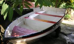 A 12 foot long speed boat for sale in good condition