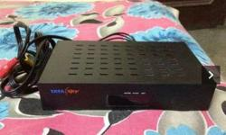 Black Tata Sky TV Box with dish remote and card it is