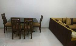 teak wood dining table with 4 chairs. thik glass to.