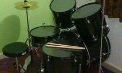 "The drum set ""DB"" + sticks. I bought it last december."