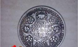 There are 3 coins ..2 coins of one rupee(1942,1947) and