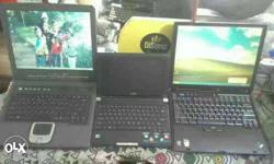 Three Black Laptop Computers