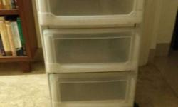 Three drawer shelf in sturdy plastic - sparingly used