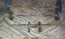 Three Gray Barbells With Weight Plates