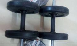 Two Black Dumbbells With Extra Weight Plates