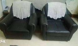 Two Black Leather Armchairs
