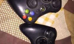 Two Black XBOX 360 Game Controllers