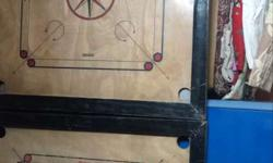 Two Brown-and-black Carrom Boards