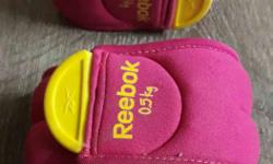 Two Pink-and-yellow Reebok Straps