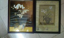 Two White Flower Paintings With Black Wooden Frames