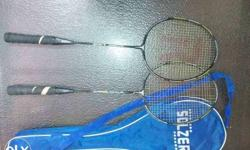 Two Yellow And Black Badminton Rackets With B Lue Case