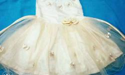 unused light golden colour baby girl dress suitable for