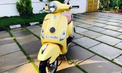 Vespa Lx 125 2012 model yellow colour... only 19000